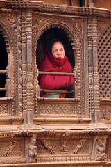 Cranky face (ejhrap) Tags: wood nepal red woman window lady carving shawl ornate bhaktapur nepali