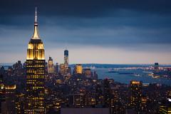 The King of the Skies (Tolkimov) Tags: nyc newyork nuevayork empire state building skyline night dusk city lights topoftherock cloudy storm