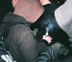 SMOKE BOMB (Anthony Cronin) Tags: ireland analog superia protest protests  protestors c41 irelanddublin bailout fuji irishlife street photography march crisis 200 dublinlife protest eirigi bank irish faces dublinirish protest streetsdublin dublinliving tpastreet dublinirelandnikonf8050mmf14d24mmf28danthonycroninanalogapug35mmfilmallrightsreservedirishphotographystreetsdublinstreetphotographystreetsofdublin antigovernment antieu antiimf irelands bailout 71210budget2010 photangoirl