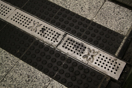 MTR logo on drain gratings: no use pinching them to reuse at home...
