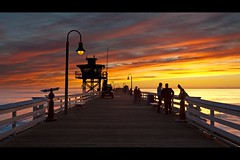 on the pier (Eric 5D Mark III) Tags: ocean california sunset sky people cloud seascape color tower lamp car silhouette canon fence landscape pier vanishingpoint twilight weekend perspective police lifeguard orangecounty sanclemente tone refleciton ef1635mmf28liiusm eos5dmarkii