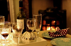 Champagne and Wine (Talliebally - on & off) Tags: fireplace wine champagne cosy flickrrocks littleboat 31122010 talithahoppe