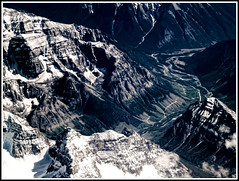 Road to Mordor (Matt Lazzarini) Tags: mist snow canada ski mountains west window misty clouds airplane rockies focus skiing view britishcolumbia seat olympus adapter e300 manual 43 oly westerncanada fourthirds flickrunitedaward