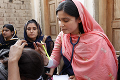 A female doctor with the International Medical Corps examines a woman patient at a mobile health clinic in Pakistan