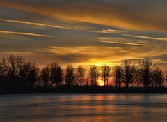 sunset in goudriaan (W.P.K.) Tags: trees sunset sky sun holland reflection ice water netherlands dutch clouds landscape photography photo nikon colorful day cloudy stock stockphoto kleurrijk stockphotography d90 goudriaan wpk
