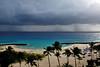 Rain curtain... (jendayee) Tags: trees sea sun beach rain clouds dark sand waves coconut sunny tourist barbados caribbean carib westindies