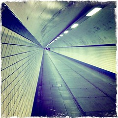 he made me suddenly realize that photographs could reach eternity through the moment (-justk-) Tags: river tunnel schelde pedestriantunnel antwerpen iphone sintannatunnel hipstamatic