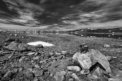 **Hardangervidda** (Klara Thomas) Tags: summer sky blackandwhite bw lake snow reflection water norway rock clouds canon landscape rocks hardanger hardangervidda buskerud canon40d klaracolor
