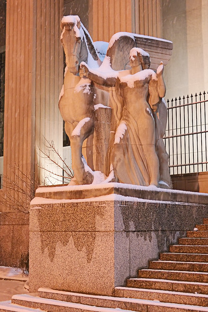 Soldiers Memorial, in downtown Saint Louis, Missouri, USA - allegorial figure, at night in the snow