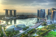 Singapore morning in HDR (UweBKK ( 77 on )) Tags: city urban water skyline architecture marina river island hotel bay singapore asia cityscape view district sony central landmark business esplanade cbd southeast alpha sands dslr fullerton 77 hdr merlion theatres greatphotographers thegalaxy