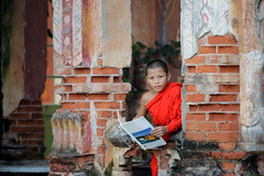Neophyte reading a book in Temple . (visootuthairam1) Tags: outdoor street cultural summer buddhist people poor traditional belief abstract religious portrait young tradition temple person rural religion buddha background child candle single book asian reading neophyte rustic little southeast happy atmospheric