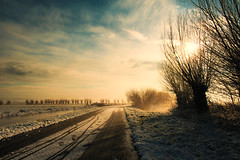 Frisian Winter Wonderland (Jurjen Harmsma Photography) Tags: road november blue autumn trees winter light sky sunlight mist nature water netherlands fog clouds sunrise fence river photography gold licht landscapes bomen blauw colours fotografie shadows air herfst nederland natuur wolken explore polar lucht filters wonderland vanishing frontpage friesland weg 2010 hek zonlicht sloot goud kleuren rivier frisian frysln landschappen schaduwen zonsopkomst airscapes verdwijnpunt canoneos1000d luchtgezichten