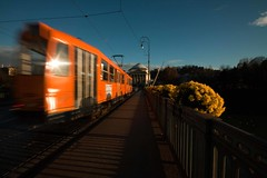 Tram (www.andreaalbertino.com) Tags: longexposure bridge flowers sunset orange bus lamp colors yellow river torino movement shadows tram wideangle ombre ponte panning turin piedmont granmadre sigma1020 fiumepo canon50d mygearandmepremium mygearandmebronze