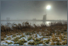 Dutch Misty Morning (Joost N.) Tags: morning vacation sun mist holiday snow cold holland green mill tourism water dutch grass amsterdam misty fog haze nikon foggy nederland typical morgen zon molen ochtend 2010 landsmeer koud oostzaan twiske