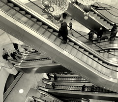 Moving up in the labyrinth (Bernard l Hermite) Tags: people bw motion mall shopping escalator perspective move shoppingcenter labyrinth labyrinthe movingup eisher