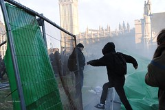 Breaking Into Parliament Square Green. (Stationary Nomads) Tags: people money david green london westminster square demo big education uniform break power ben cut political politics nick rally central protest police parliament running run clash demonstration cameron future government conservative coalition rise cuts protesters fees fee tuition liberaldemocrats libdems clegg clashes condem dayx3