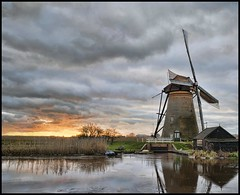 dutch windmill 3 (Wim Koopman) Tags: sunset sky holland mill water netherlands windmill dutch clouds river photography photo nikon ditch stock dike kinderdijk stockphoto stockphotography d90 wpk