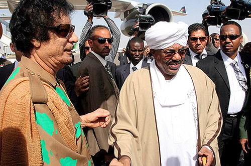 Libya leader Muammar Qaddafi with Sudan President Omar Hassan al-Bashir in Khartoum. Libya, Egypt and Mauritania have sent their leaders to Sudan in an effort to minimize tensions in the run-up to the Jan. 11, 2010 referendum on the future of the South. by Pan-African News Wire File Photos
