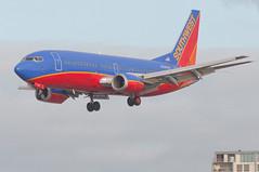 Southwest flight 670 from Oakland at San Diego (SBGrad) Tags: aperture nikon sandiego boeing nikkor 737 southwestairlines 2010 alr d90 ksan 737300 aerotagged 7373h4 80200mmf28dafs n338sw aero:series=300 aero:man=boeing aero:model=737 aero:airline=swa aero:airport=ksan aero:tail=n338sw