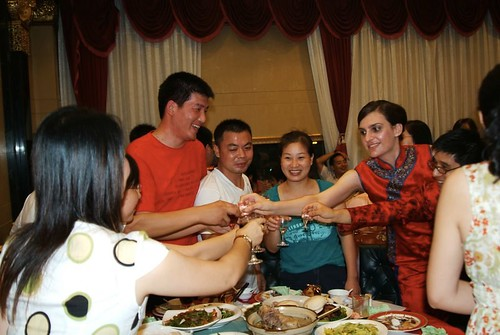 Toasting people with my Chinese husband at our wedding banquet