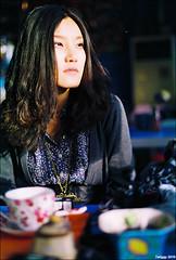the Beijing girl (Twiggy Tu) Tags: china portrait film girl beijing coffeeshop nikkor50mmf18 nikonfm2 2010 liangdu