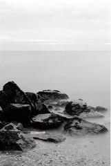 On The Rocks (mankamen et ella) Tags: red bw nature landscape 50mm nikon kodak grain d76 filter malaysia slowshutter kuala af f80 nikkor milf ilford fp4 pantai fju selangor 18d cokin rsm remis selfdevelop filmforever manilovefilm randomshotmalaysia filmjunkiesunite filemmalaya
