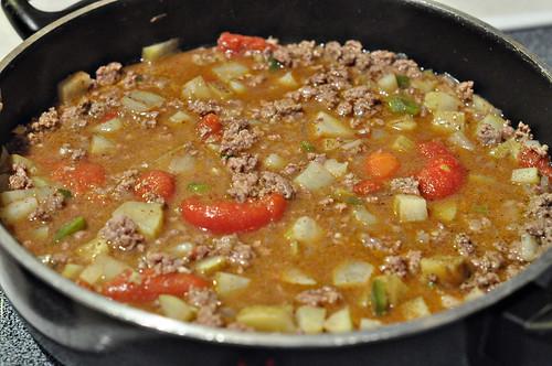 Simmer beef and veggies in seasoned broth