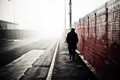 Into the fog (Funky64 (www.lucarossato.com)) Tags: city winter man fog alone uomo solo nebbia inverno asfalto lombardia citt pianura asfalt cantiere padania recinto legnano lucarossato funky64