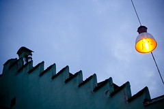 ufo girl approach (batintherain) Tags: light sky orange house lamp lines streetlamp steps roofs southtyrol merano meran