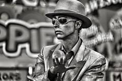 Mr. Statue (Melissa_JMH) Tags: man statue mrstatue silver paint oregon juggle juggling oregonstatefair outside outdoors rain sunglasses reflection nikon nikond700 d700 guy hat ball orb jacket performance streetperformer performer dof depthoffield