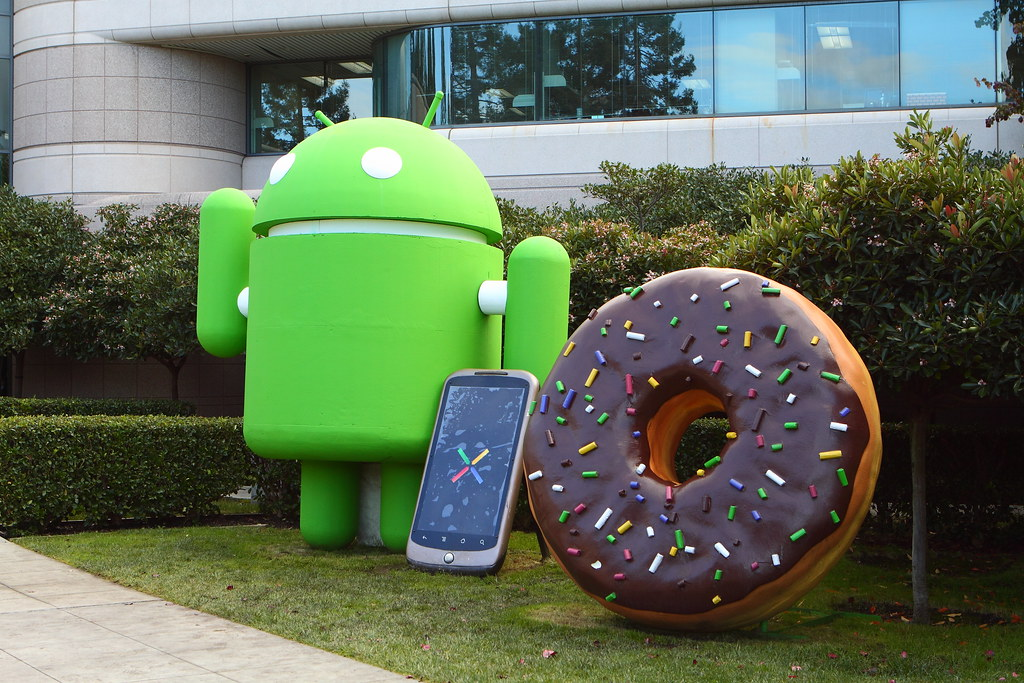 BigDroid Android mascot, N1 phone, and donut.