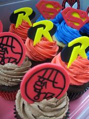 Superhero Cupcakes (Jenny Burgesse) Tags: robin cupcakes superman superhero hellboy fondant geeksweets comicbookshoppeartgala2010