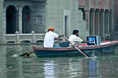 Paddling with TV is much nicer (Stphane Gisiger) Tags: travel india television river boat tv nikon north paddle varanasi 70200 ganga d90