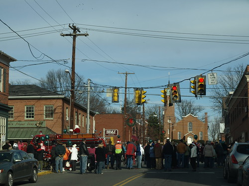 Santa Claus rides the fire truck through Berryville