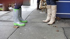Rain Boots Meet Leather Boots (Lynn Friedman) Tags: sf sanfrancisco ca street people usa white painterly black blur streets green rain fashion pattern boots tan rubber flats sidewalk heels theme wellies impressionistic unionstreet unionst streetsandpeople lynnfriedman friedmanlynn