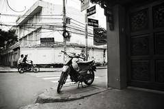 Motorbike, Ho Chi Minh City, Vietnam (Seven Seconds Before Sunrise) Tags: park street travel people bw man sign asia southeastasia vietnam motorbike powerlines crosswalk moped saigon hochiminhcity bikers hcmc