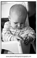 Portrait of a baby in a high chair (JasonNoffsinger) Tags: portrait blackandwhite bw baby monochrome kid infant child documentary highchair nikonn90s dr5 ilfordhp5plus sigmasd9 nikon50mmf18 sigma50mmf28macro camerascan photosolvextendaslide