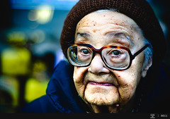 1000 Faces of Canada # 0011 (Through Painted Eyes) Tags: old city people urban woman lady glasses la italian faces character painted ottawa elderly optimism bottega street photography eyes through canada 1000 streetphotographycandidstreetportrait