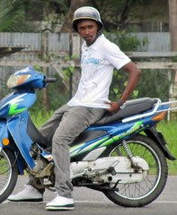 Best Foot Forward (Legin_2009) Tags: road street man black male men guy bike sitting ride african helmet guys sneakers dude jeans motorbike sit moto males caribbean poloshirt dudes rider mec mecs