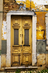 Here we go (steverichard) Tags: street door travel house building portugal window yellow canon photo casa europe peeling paint image decay entrada 5d porte portal algarve grime tamron portuguese flaky crusty crumbling olhao portugues turen 2875 img7481 steverichard dwwg srichardimages