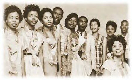 a sepia photograph of the Little Rock 9 students and Daisy Bates, who is seated.