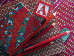 Books and pencils (Lucy Patterson) Tags: red crimson pencil vintage scarlet paper japanese origami stamps buttons brooch stamp cotton badge bracelet fireengine bangle buckle papercut toytrains bloodred