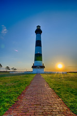 Bodie Island Lighthouse OBX Cape Hatteras North Carolina (DigiDreamGrafix.com) Tags: autumn copyright lighthouse fog architecture sunrise landscape outdoors island dawn coast early wooden nc stripes seasonal north landmark structure historic hatteras coastal national carolina boardwalk cape bodie outer eastern outerbanks seashore radiant banks obx daymark