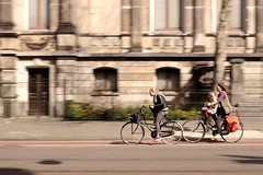 Amsterdam (Fulvio Frioli) Tags: life street city light people urban woman motion holland girl bike bicycle movement europa europe shot natural path 28mm wide nederland fast style scene bicycles cycle lane bici xxx nikkor panning pista luce olanda ciclabile paesibassi nikond90