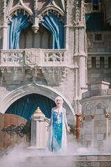 Queen Elsa letting things go (Daniel A Ruiz) Tags: disney portrait queen elsa letitgo castle cinderella smoke woman singing frozen outdoor magickingdom