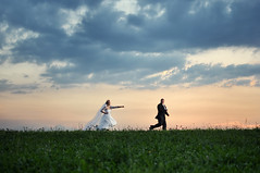 Natalia & Sylwester - wedding session (Krzysztof Zitarski) Tags: wedding sunset green grass horizontal clouds composition groom bride hill central running superman pursuit bridezilla d90 3518