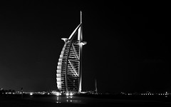 Burj Al Arab (DodogoeSLR) Tags: longexposure sea bw white black beach night lights hotel boat insane nikon dubai uae burjalarab sail nikkor luxury unitedarabemirates 7star jumeirah 16mmf35 sailboathotel