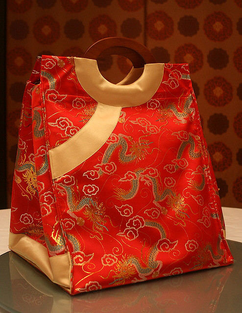 The Imperial Pen Cai takeaway comes in a festive carrier inspired by imperial robes