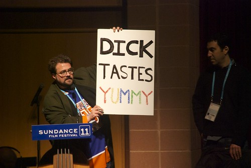 Kevin Smith Holds Up a Sign