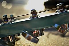 head lines (Laurarama) Tags: macro lines closeup nikon bokeh guitar head turquoise gap dec strings pegs odc blueguitar guitarhead d3100